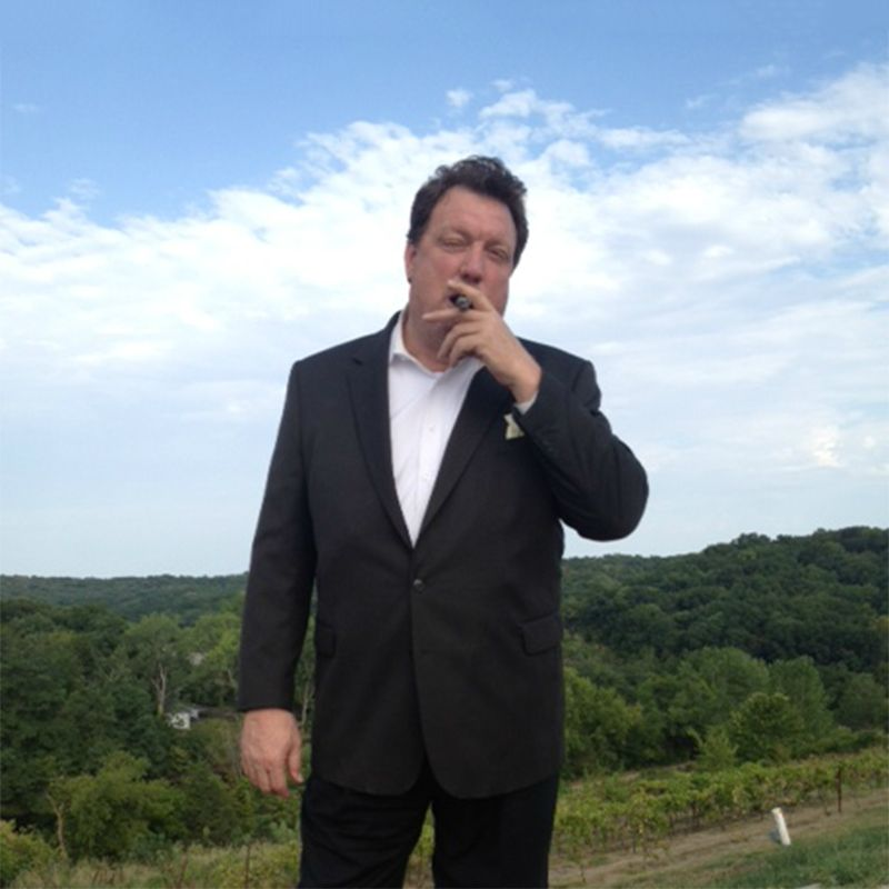 Gillis C. Leonard outside smoking cigar